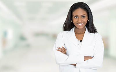 A woman standing in an office smiling