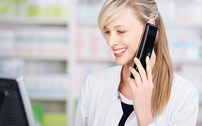 A woman talking on the phone while smiling
