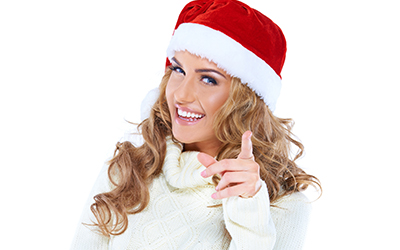 Woman smiling with santa hat