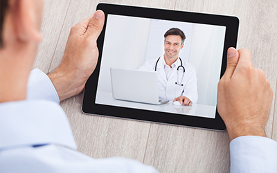 A patient talking with a doctor on an Ipad