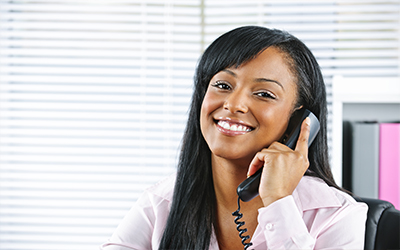 A woman talking on the phone and smiling